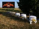 Пикник сред природата със скара, маси и столове от
